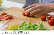 Купить «woman chopping tomato with kitchen knife at home», видеоролик № 32298225, снято 10 октября 2019 г. (c) Syda Productions / Фотобанк Лори
