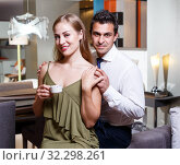 Купить «Loving couple in apartment», фото № 32298261, снято 24 сентября 2018 г. (c) Яков Филимонов / Фотобанк Лори