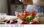 Купить «woman cooking vegetable salad with lemon at home», видеоролик № 32298273, снято 10 октября 2019 г. (c) Syda Productions / Фотобанк Лори