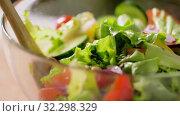 fresh vegetable salad in glass bowl. Стоковое видео, видеограф Syda Productions / Фотобанк Лори