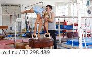 Купить «Couple train elements on pommel horse», фото № 32298489, снято 18 июля 2018 г. (c) Яков Филимонов / Фотобанк Лори