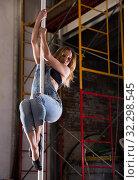 Купить «Beautiful slim girl with pylon. Female pole dancer woman dancing on a pole», фото № 32298545, снято 8 декабря 2019 г. (c) Яков Филимонов / Фотобанк Лори