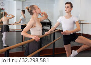 Купить «Choreographer helping young man dancer to have right position. Exercising at the barre by the mirror», фото № 32298581, снято 26 апреля 2019 г. (c) Яков Филимонов / Фотобанк Лори