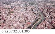 Купить «Aerial view of Murcia cityscape with a segura river and apartment buildings, Spain», видеоролик № 32301305, снято 17 апреля 2019 г. (c) Яков Филимонов / Фотобанк Лори