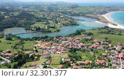 Купить «Aerial panoramic view of summer landscape overlooking small Spanish town of Comillas on coast of Cantabrian Sea», видеоролик № 32301377, снято 14 июля 2019 г. (c) Яков Филимонов / Фотобанк Лори