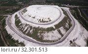 Купить «Phosphogypsum White mountain aerial view. City Voskresenks. Russia», видеоролик № 32301513, снято 12 мая 2019 г. (c) Яков Филимонов / Фотобанк Лори