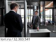 Купить «Man at airport security gates putting out phone and keys», фото № 32303541, снято 20 ноября 2019 г. (c) easy Fotostock / Фотобанк Лори