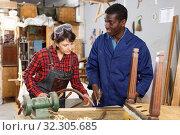 Купить «Artisans in process of renewing armchair», фото № 32305685, снято 2 февраля 2019 г. (c) Яков Филимонов / Фотобанк Лори