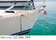 White yacht bow with mooring ropes. Стоковое фото, фотограф EugeneSergeev / Фотобанк Лори