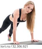 Купить «Young fitness trainer exercising on step platform», фото № 32306921, снято 25 сентября 2016 г. (c) Гурьянов Андрей / Фотобанк Лори