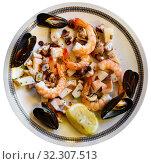 Купить «Frittura di mare - plate with various seafood. Italian food», фото № 32307513, снято 12 ноября 2019 г. (c) Яков Филимонов / Фотобанк Лори