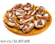 Купить «Bread with butter and salted anchovy fillets», фото № 32307605, снято 10 апреля 2020 г. (c) Яков Филимонов / Фотобанк Лори