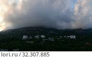 Купить «Clouds float on top of a mountain in Foros, Crimea. timelapse», видеоролик № 32307885, снято 4 июля 2019 г. (c) Володина Ольга / Фотобанк Лори