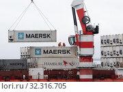 Купить «Crane unloads container ship Sevmorput - Russian nuclear-powered icebreaker lighter aboard ship carrier. Container terminal seaport», фото № 32316705, снято 26 августа 2019 г. (c) А. А. Пирагис / Фотобанк Лори