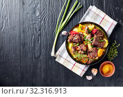 Купить «overhead view of Jamaican spicy Curry Goat», фото № 32316913, снято 1 июля 2019 г. (c) Oksana Zh / Фотобанк Лори