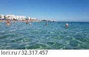 Купить «Protaras, Cyprus - Oct 12. 2019. People swim in the sea at the Famous Sunrise Beach», видеоролик № 32317457, снято 20 октября 2019 г. (c) Володина Ольга / Фотобанк Лори