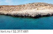 Купить «View from the sea to Cavo Greco in Protaras, Cyprus», видеоролик № 32317681, снято 21 октября 2019 г. (c) Володина Ольга / Фотобанк Лори