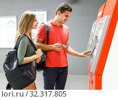 Купить «Couple is buying tickets», фото № 32317805, снято 14 июня 2018 г. (c) Яков Филимонов / Фотобанк Лори