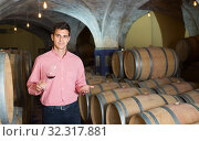 young man posing in winery cellar. Стоковое фото, фотограф Яков Филимонов / Фотобанк Лори
