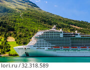Купить «Luxury cruise liner MSC Meraviglia  In The Fjord Of Olden Norway», фото № 32318589, снято 26 мая 2020 г. (c) Николай Коржов / Фотобанк Лори