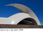 Tenerife, Spain -October 14, 2019: Exterior of famous place Auditorio de Tenerife, architectural symbol the city of Santa Cruz de Tenerife, Canary Islands, Spain. Designed by Santiago Calatrava, Spain. Редакционное фото, фотограф Alexander Tihonovs / Фотобанк Лори