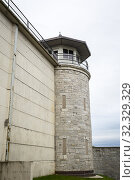 Купить «Guard tower at Kingston Penitentiary a former maximum security prison that opened June 1835 and closed September 2013 now open for Jailhouse Tours Ontario Canada.», фото № 32329329, снято 27 августа 2019 г. (c) age Fotostock / Фотобанк Лори