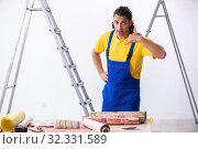 Купить «Young man contractor doing renovation at home», фото № 32331589, снято 4 июня 2019 г. (c) Elnur / Фотобанк Лори