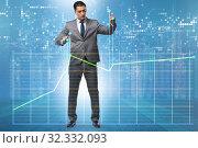 Купить «Businessman controlling the market with strings», фото № 32332093, снято 5 декабря 2019 г. (c) Elnur / Фотобанк Лори