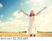 Купить «smiling young woman in white dress on cereal field», фото № 32332681, снято 31 июля 2016 г. (c) Syda Productions / Фотобанк Лори