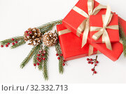 christmas gifts and fir branches with pine cones. Стоковое фото, фотограф Syda Productions / Фотобанк Лори