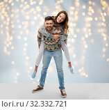 Купить «happy couple at christmas ugly sweater party», фото № 32332721, снято 9 декабря 2018 г. (c) Syda Productions / Фотобанк Лори