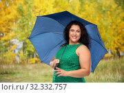 Купить «happy woman with blue umbrella over autumn park», фото № 32332757, снято 15 сентября 2019 г. (c) Syda Productions / Фотобанк Лори