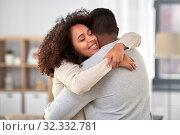 Купить «happy african american couple hugging at home», фото № 32332781, снято 22 сентября 2019 г. (c) Syda Productions / Фотобанк Лори