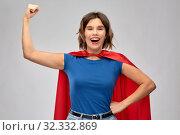 happy woman in red superhero cape showing power. Стоковое фото, фотограф Syda Productions / Фотобанк Лори