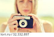 Купить «close up of woman photographing with film camera», фото № 32332897, снято 31 июля 2016 г. (c) Syda Productions / Фотобанк Лори