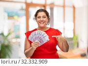 Купить «happy woman showing euro money banknotes», фото № 32332909, снято 15 сентября 2019 г. (c) Syda Productions / Фотобанк Лори