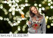 Купить «woman in christmas sweater with reindeer pattern», фото № 32332961, снято 9 декабря 2018 г. (c) Syda Productions / Фотобанк Лори