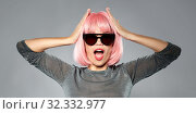 happy woman in pink wig and black sunglasses. Стоковое фото, фотограф Syda Productions / Фотобанк Лори
