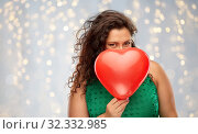 Купить «playful woman holding red heart shaped balloon», фото № 32332985, снято 15 сентября 2019 г. (c) Syda Productions / Фотобанк Лори