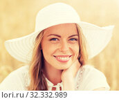 Купить «close up of happy woman in sun hat on cereal field», фото № 32332989, снято 31 июля 2016 г. (c) Syda Productions / Фотобанк Лори