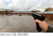 Купить «POV of male hands shooting with semi-automatic gun», фото № 32333061, снято 11 октября 2019 г. (c) Syda Productions / Фотобанк Лори