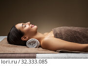 Купить «young woman lying at spa or massage parlor», фото № 32333085, снято 13 октября 2019 г. (c) Syda Productions / Фотобанк Лори