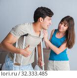 Купить «The young wife supporting husband on crutch after injury», фото № 32333485, снято 9 августа 2017 г. (c) Elnur / Фотобанк Лори