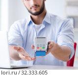 Купить «Man processing credit card transaction with POS terminal», фото № 32333605, снято 7 июля 2017 г. (c) Elnur / Фотобанк Лори