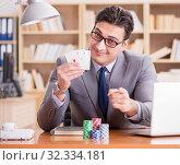 Купить «Businessman gambling playing cards at work», фото № 32334181, снято 18 января 2017 г. (c) Elnur / Фотобанк Лори