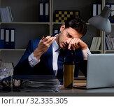 Купить «Businessman tired and sleeping in the office after overtime hour», фото № 32335305, снято 21 декабря 2017 г. (c) Elnur / Фотобанк Лори
