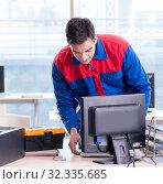 Купить «The computer repairman specialist repairing computer desktop», фото № 32335685, снято 19 января 2018 г. (c) Elnur / Фотобанк Лори