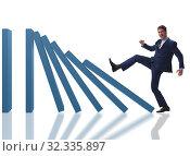 Купить «Businessman in domino effect business concept», фото № 32335897, снято 28 января 2020 г. (c) Elnur / Фотобанк Лори
