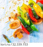 Купить «Vegetarian skewers white mushrooms, peppers and zucchini for barbecue», фото № 32339153, снято 9 апреля 2020 г. (c) easy Fotostock / Фотобанк Лори