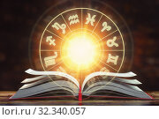 Купить «Astrology horoscope concept. Opened book with magic zodiac signs and symbols.», фото № 32340057, снято 22 февраля 2020 г. (c) Maksym Yemelyanov / Фотобанк Лори